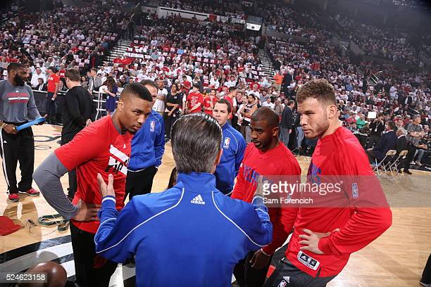 Damian Lillard of the Portland Trail Blazers along with Chris Paul and Blake Griffin of the Los Angeles Clippers talk with the referee before the...
