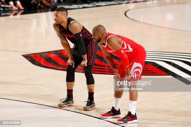 Damian Lillard of the Portland Trail Blazers and Chris Paul of the Houston Rockets looks on during the game on March 20 2018 at the Moda Center in...