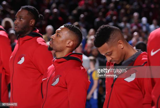 Damian Lillard of the Portland Trail Blazers and CJ McCollum of the Portland Trail Blazers look on during the national anthem prior to the game...