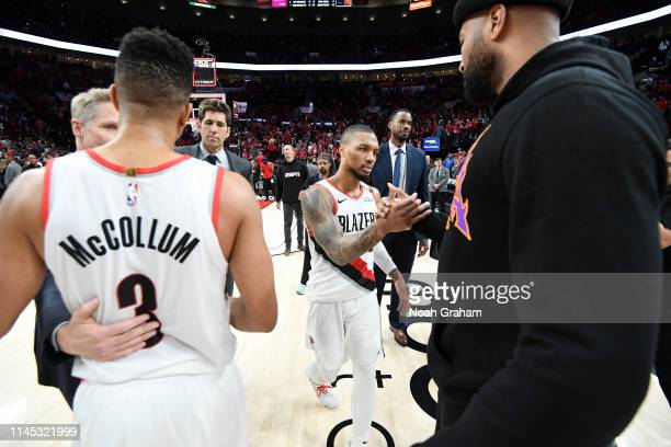 Damian Lillard of the Portland Trail Blazers and DeMarcus Cousins of the Golden State Warriors embrace following Game Four of the Western Conference...