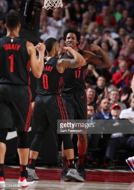 Damian Lillard of the Portland Trail Blazers and Ed Davis of the Portland Trail Blazers react during the game against the Golden State Warriors on...