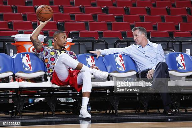 Damian Lillard of the Portland Trail Blazers and General Manager Neil Olshey are seen before the game against the Los Angeles Clippers on October 27...