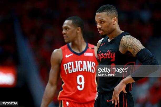 Damian Lillard of the Portland Trail Blazers and Rajon Rondo of the New Orleans Pelicans stand on the court during Game 3 of the Western Conference...