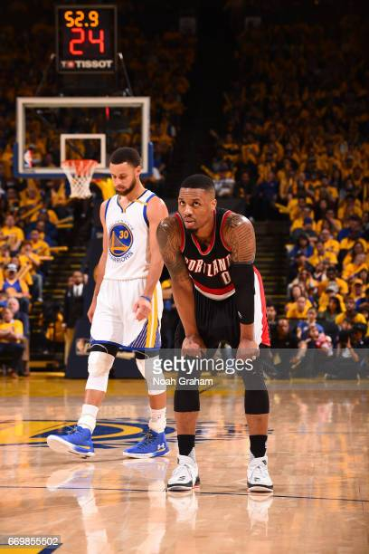 Damian Lillard of the Portland Trail Blazers and Stephen Curry of the Golden State Warriors walk up court during the Western Conference Quarterfinals...