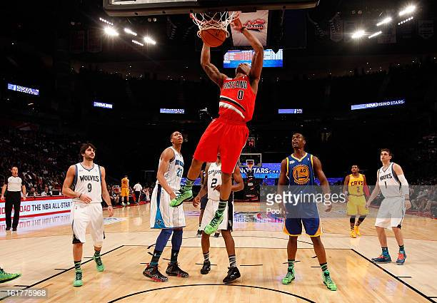 Damian Lillard of the Portland Trail Blazers and Team Shaq dunks the ball in the first half in the BBVA Rising Stars Challenge 2013 part of the 2013...
