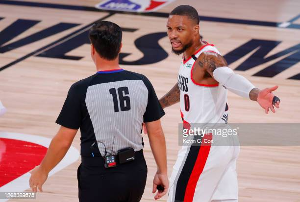 Damian Lillard of the Portland Trail Blazers argues with referee David Guthrie during the first quarter against the Los Angeles Lakers in Game Four...