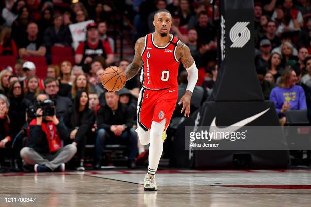 Damian Lillard of the Portland Trail Blazers brings the ball down the court during the second half of the game against the Phoenix Suns at the Moda...