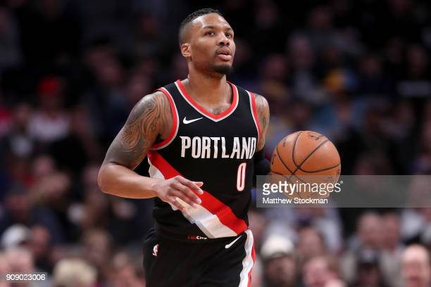 Damian Lillard of the Portland Trail Blazers brings the ball down the court against the Denver Nuggets at the Pepsi Center on January 22 2018 in...
