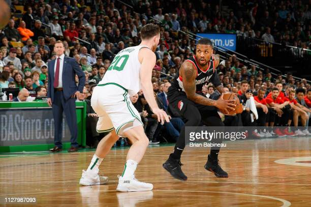 Damian Lillard of the Portland Trail Blazers brings the ball up court during the game against Gordon Hayward of the Boston Celtics on February 27...