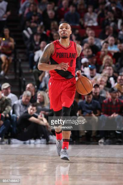 Damian Lillard of the Portland Trail Blazers brings the ball up court against the Cleveland Cavaliers on March 15 2018 at the Moda Center Arena in...