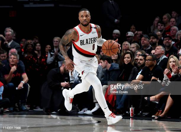 Damian Lillard of the Portland Trail Blazers brings the ball up the court during the first half of Game One of the Western Conference quarterfinals...