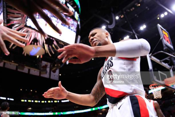 Damian Lillard of the Portland Trail Blazers celebrates a basket with teammates in the fourth quarter against the Miami Heat at American Airlines...