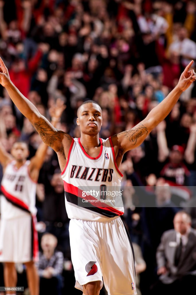 Damian Lillard #0 of the Portland Trail Blazers celebrates after making the game-winning three-pointer against the New Orleans Hornets on December 16, 2012 at the Rose Garden Arena in Portland, Oregon.