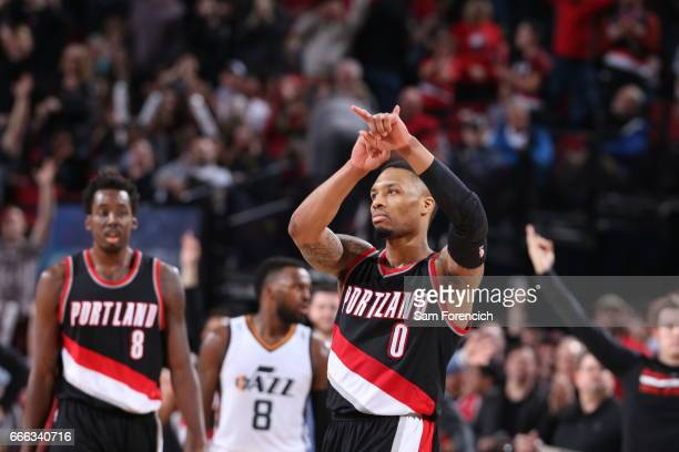 Damian Lillard of the Portland Trail Blazers celebrates after scoring 59 points against the Utah Jazz on April 8 2017 at the Moda Center in Portland...