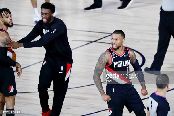 Damian Lillard of the Portland Trail Blazers celebrates after defeating the Dallas Mavericks 134-131 at The Field House at ESPN Wide World Of Sports...