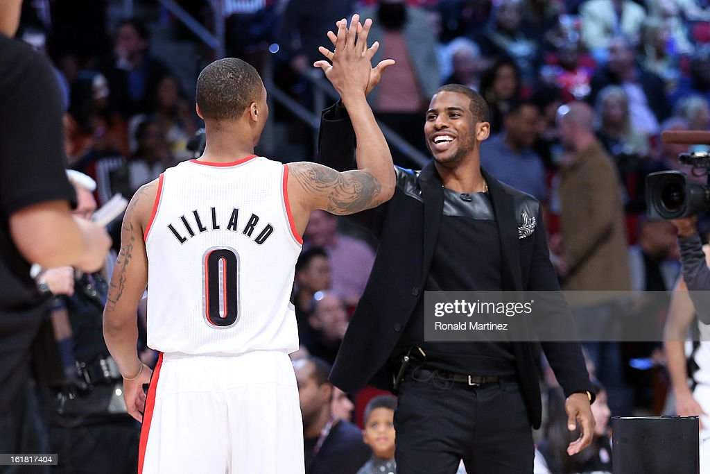 Damian Lillard of the Portland Trail Blazers celebrates with captain Chris Paul of the Los Angeles Clippers after Lillard wins the Taco Bell Skills Challenge part of 2013 NBA All-Star Weekend at the Toyota Center on February 16, 2013 in Houston, Texas.