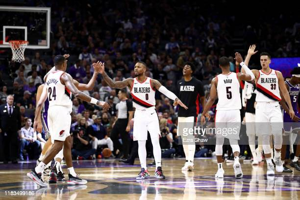 Damian Lillard of the Portland Trail Blazers congratulates teammates during a time out of their game against the Sacramento Kings at Golden 1 Center...