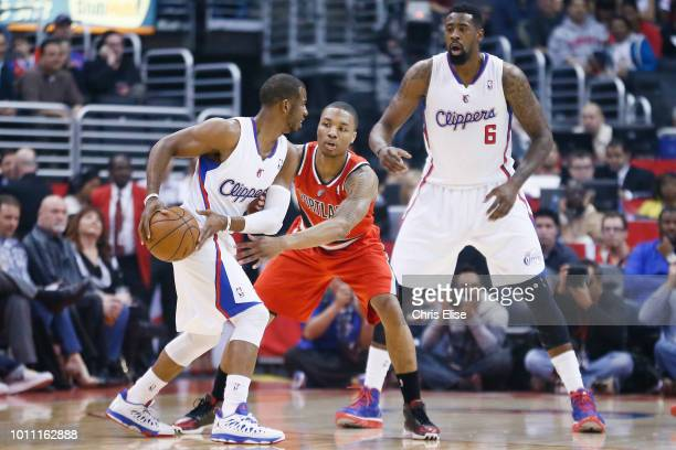 Damian Lillard of the Portland Trail Blazers defends against Chris Paul of the Los Angeles Clippers on April 16 2013 at STAPLES Center in Los Angeles...
