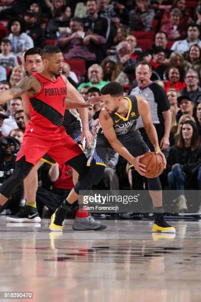 Damian Lillard of the Portland Trail Blazers defends against Stephen Curry of the Golden State Warriors during the game between the two teams on...