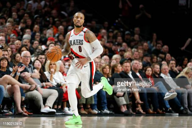 Damian Lillard of the Portland Trail Blazers dribbles against the Golden State Warriors in game three of the NBA Western Conference Finals at Moda...
