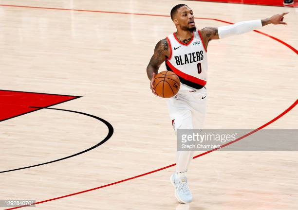 Damian Lillard of the Portland Trail Blazers dribbles against the Utah Jazz during the first half at Moda Center on December 23, 2020 in Portland,...