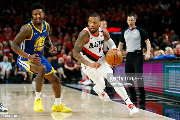 Damian Lillard of the Portland Trail Blazers dribbles during the second half against the Golden State Warriors in game four of the NBA Western...