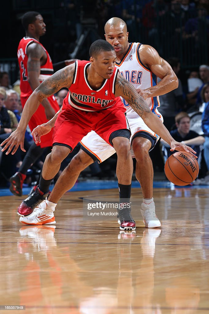Damian Lillard #0 of the Portland Trail Blazers dribbles the ball against the Oklahoma City Thunder on March 24, 2013 at the Chesapeake Energy Arena in Oklahoma City, Oklahoma.