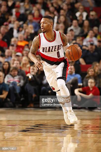 Damian Lillard of the Portland Trail Blazers dribbles the ball against the Toronto Raptors on February 4 2016 at the Moda Center in Portland Oregon...