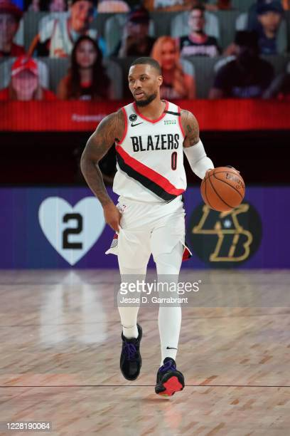 Damian Lillard of the Portland Trail Blazers dribbles the ball up court during Round One Game Four of the NBA Playoffs on August 22 2020 at...
