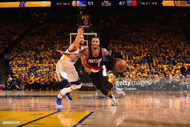 Damian Lillard of the Portland Trail Blazers dribbles the ball while guarded by Stephen Curry of the Golden State Warriors during the Western...