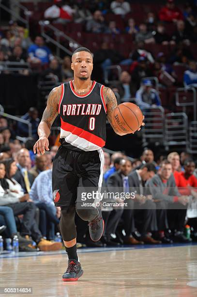 Damian Lillard of the Portland Trail Blazers dribbles up court against the Philadelphia 76ers at Wells Fargo Center on January 16 2015 in...