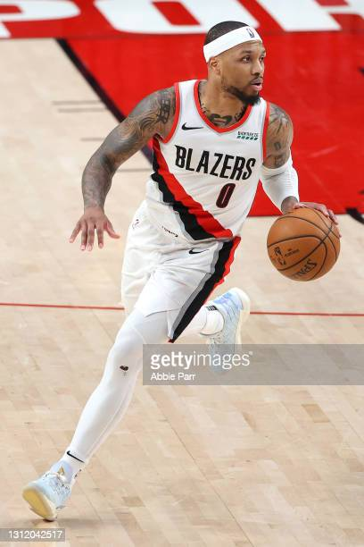 Damian Lillard of the Portland Trail Blazers dribbles with the ball in the third quarter against the Miami Heat at Moda Center on April 11, 2021 in...