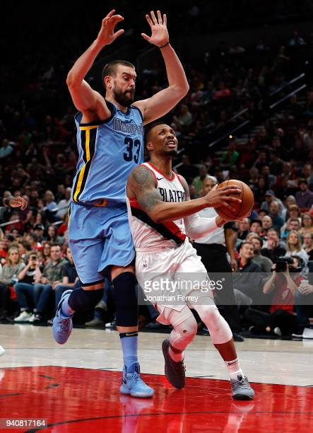 Damian Lillard of the Portland Trail Blazers drives against Marc Gasol of the Memphis Grizzlies at Moda Center on April 1 2018 in Portland OregonNOTE...