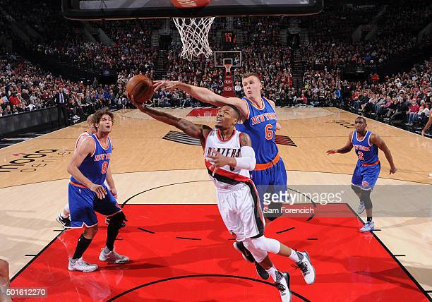 Damian Lillard of the Portland Trail Blazers drives to the basket and gets his shot blocked by Kristaps Porzingis of the New York Knicks on December...