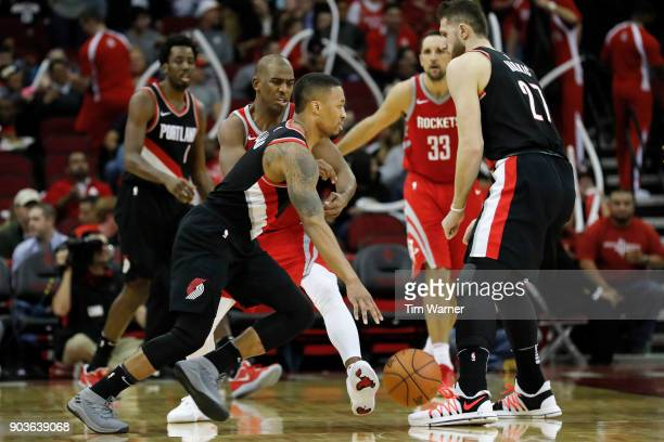 Damian Lillard of the Portland Trail Blazers drives to the basket defended by Chris Paul of the Houston Rockets in the second half at Toyota Center...