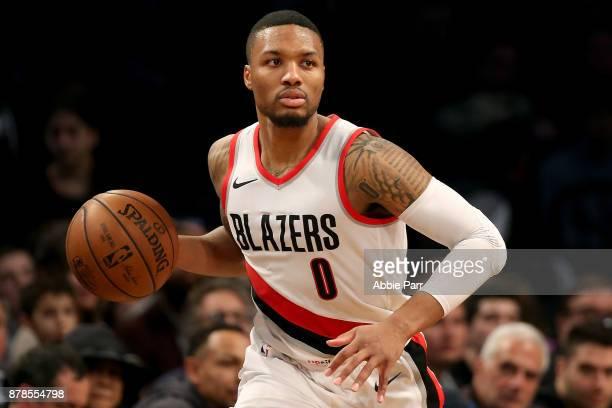 Damian Lillard of the Portland Trail Blazers drives to the basket in the third quarter against the Brooklyn Nets at Barclays Center on November 24...