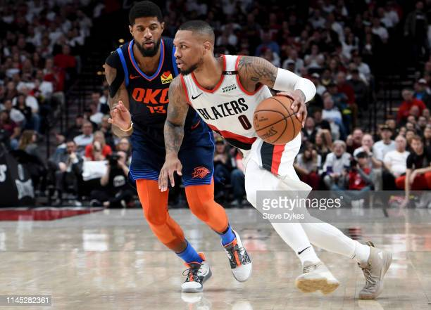 Damian Lillard of the Portland Trail Blazers drives to the basket on Paul George of the Oklahoma City Thunder during the second half of Game Five of...