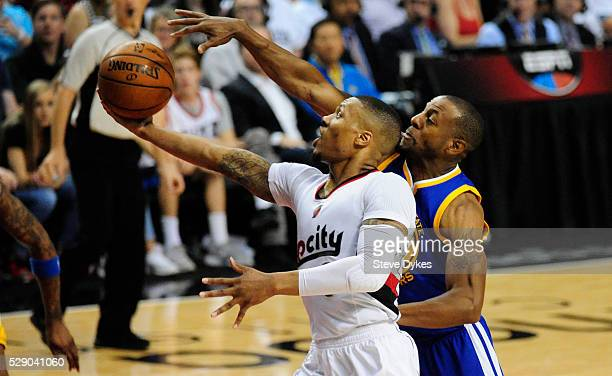 Damian Lillard of the Portland Trail Blazers drives to the basket on Andre Iguodala of the Golden State Warriors in the third quarter of Game Three...