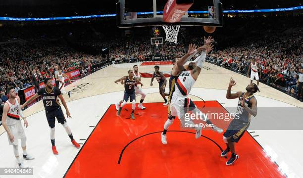 Damian Lillard of the Portland Trail Blazers drives to the basket on Nikola Mirotic of the New Orleans Pelicans during the first half of game one of...