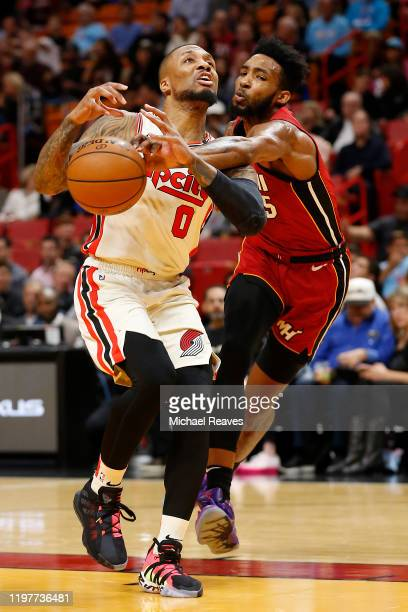 Damian Lillard of the Portland Trail Blazers drives to the basket against Derrick Jones Jr #5 of the Miami Heat during the first half at American...