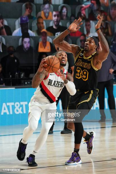 Damian Lillard of the Portland Trail Blazers drives to the basket against the Los Angeles Lakers during Round One Game Four of the NBA Playoffs on...