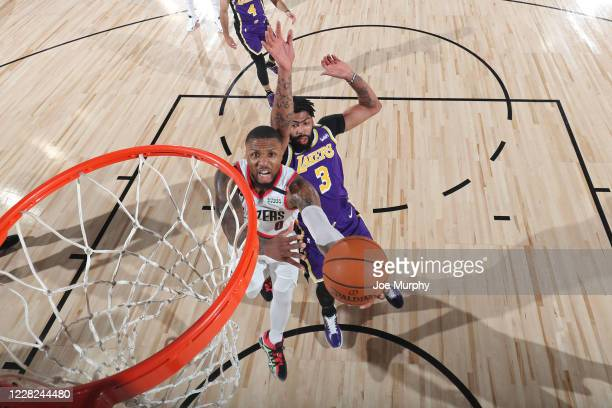 Damian Lillard of the Portland Trail Blazers drives to the basket against the Los Angeles Lakers during Round One Game Three on August 22 2020 in...