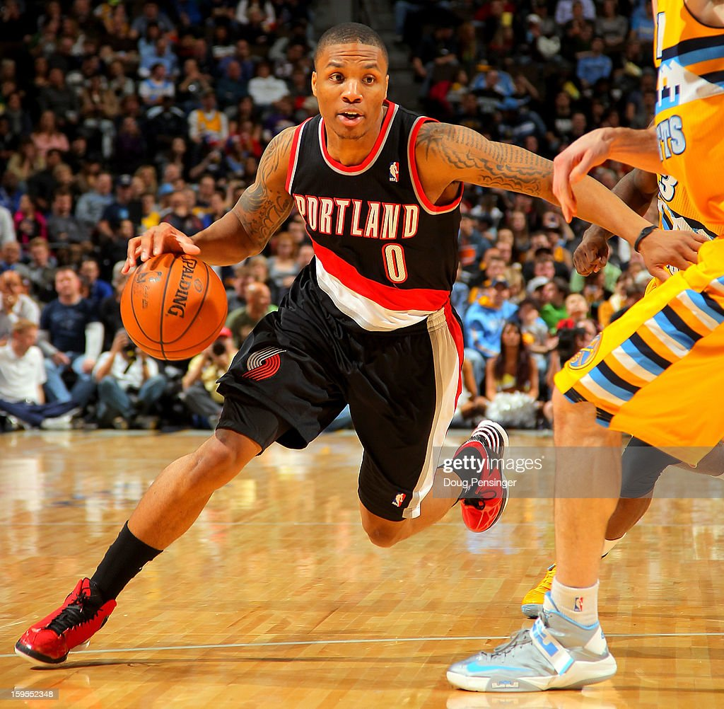 Damian Lillard #0 of the Portland Trail Blazers drives to the basket against the Denver Nuggets at the Pepsi Center on January 15, 2013 in Denver, Colorado.