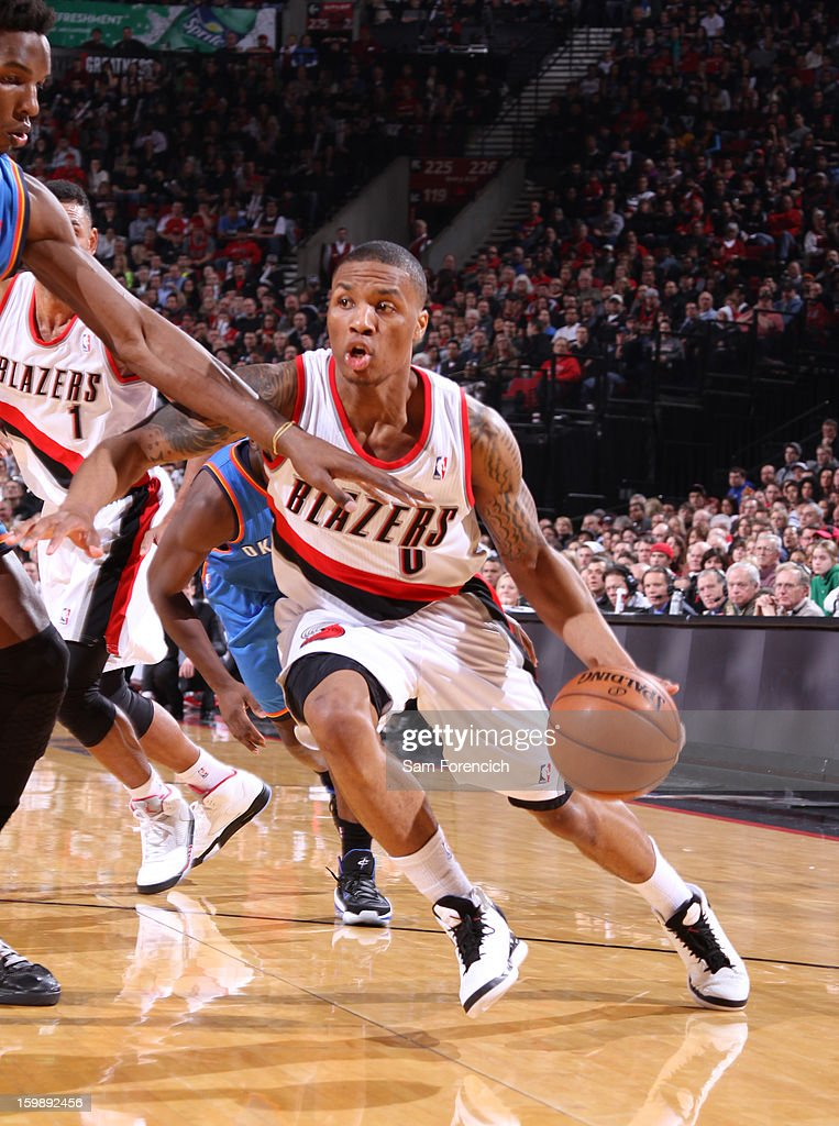 Damian Lillard #0 of the Portland Trail Blazers drives to the basket against the Oklahoma City Thunder on January 13, 2013 at the Rose Garden Arena in Portland, Oregon.