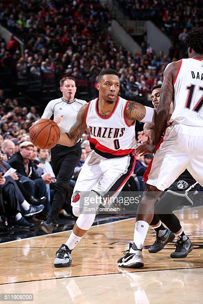 Damian Lillard of the Portland Trail Blazers drives to the basket during the game against the Brooklyn Nets on February 23 2016 at the Moda Center...