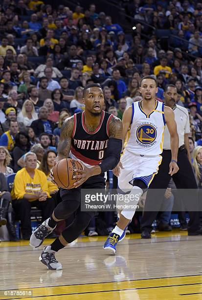 Damian Lillard of the Portland Trail Blazers drives to the basket past Stephen Curry of the Golden State Warriors during an NBA basketball game at...
