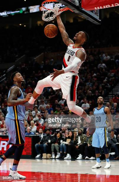 Damian Lillard of the Portland Trail Blazers dunks against the Memphis Grizzlies at Moda Center on April 1 2018 in Portland OregonNOTE TO USER User...