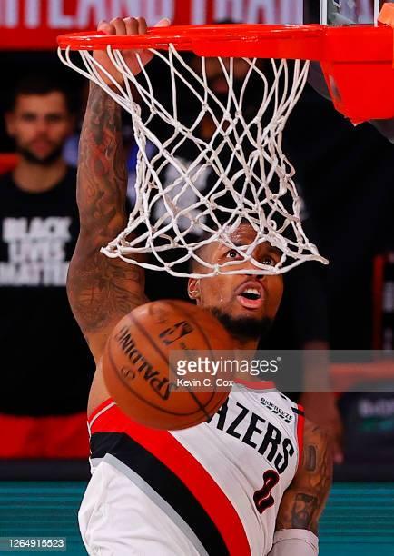 Damian Lillard of the Portland Trail Blazers dunks against the Philadelphia 76ersduring the fourth quarter at Visa Athletic Center at ESPN Wide World...