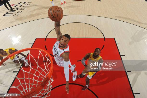 Damian Lillard of the Portland Trail Blazers dunks the ball against the Los Angeles Lakers on October 18 2018 at the Moda Center Arena in Portland...
