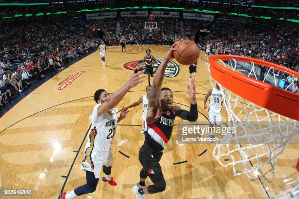 Damian Lillard of the Portland Trail Blazers dunks the ball during the game against the New Orleans Pelicans on March 27 2018 at the Smoothie King...